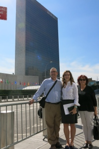 Caroline with her parents in front of the UN.