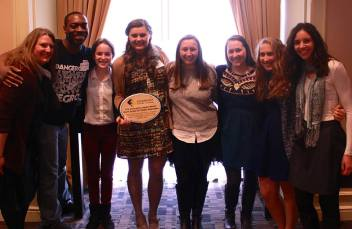 A few members of the Youth United for Global Action (YUGA) network accepting The Emerging Leader Award